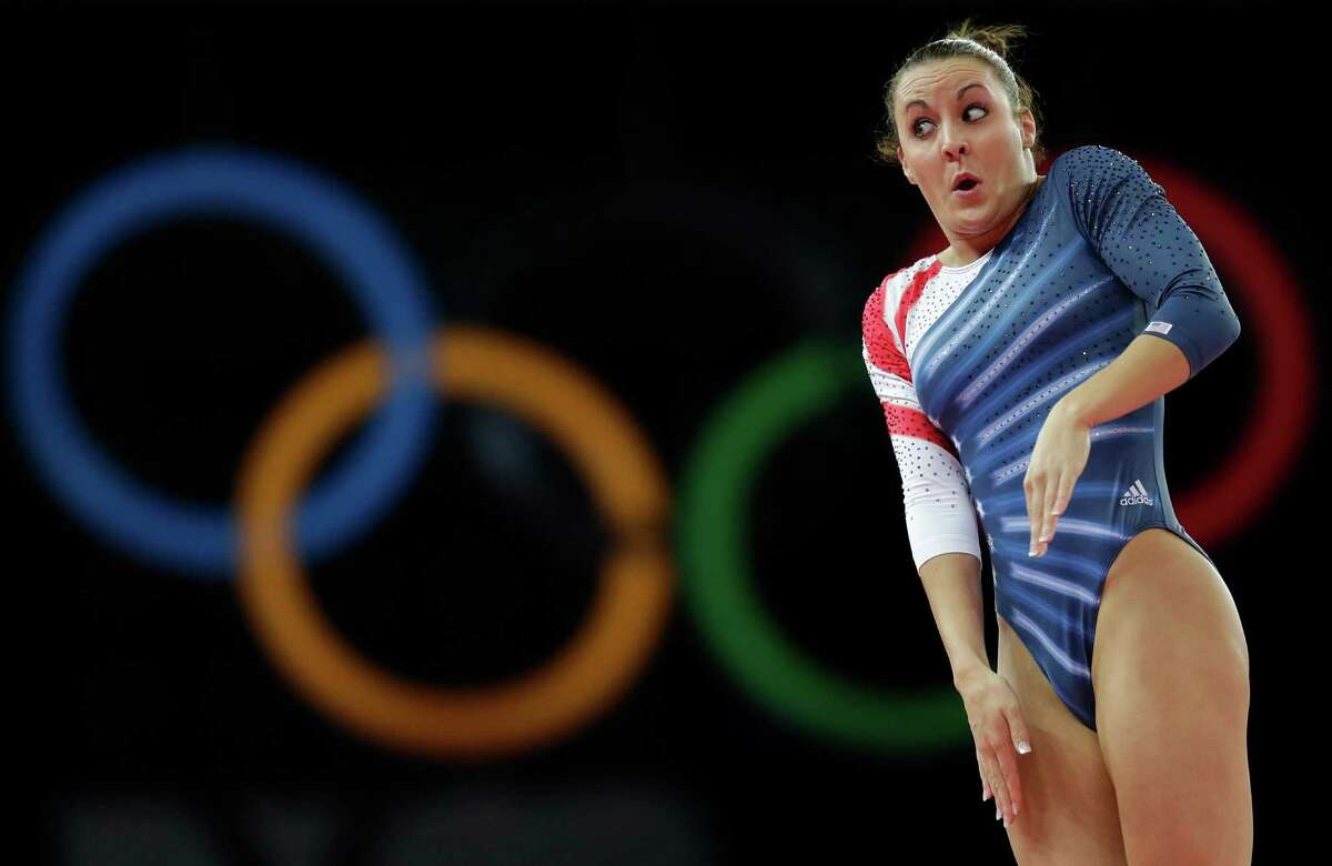 Savannah Vinsant from the U.S. performs during the women's trampoline qualification at the 2012 Summer Olympics, Friday, Aug. 3, 2012, in London. (AP Photo/Julie Jacobson)