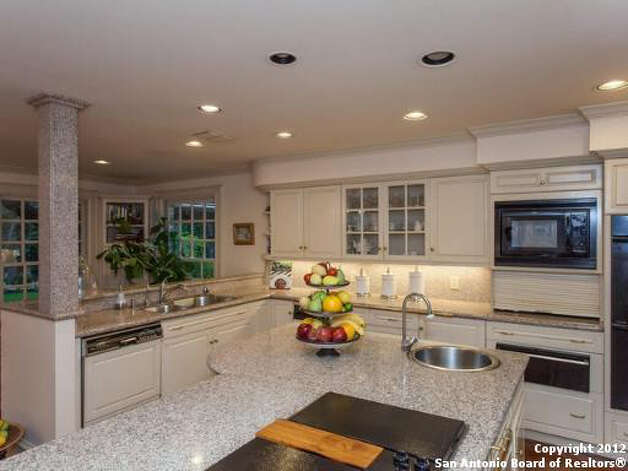 The kitchen has a considerable amount of counter and cabinet space, including a center island.