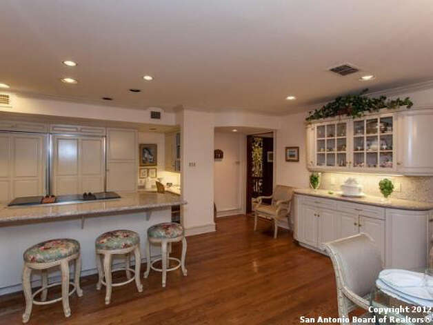 The kitchen also features a breakfast bar and top of the line appliances.
