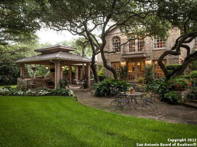 The cobblestone patio is surrounding by a beautiful landscaped yard. Photo Illustration