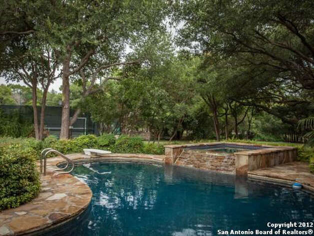 Despite the patio and pool area, a great deal of the back yard remains undeveloped. Photo Illustration