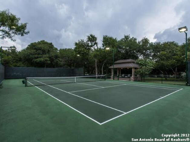 One of the highlights of the exterior of the property is the private tennis court. Photo Illustration