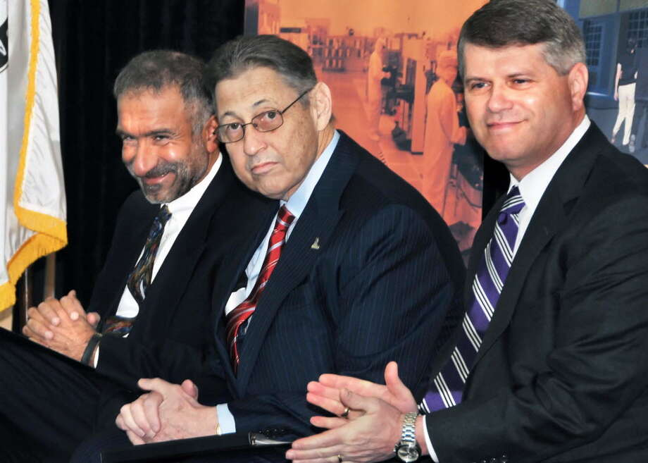 Rick Whitney, the CEO of M+W Group's U.S. operations, with Assembly Speaker Sheldon Silver, center, and Alain Kaloyeros, CEO of the University at Albany's College of Nanoscale Science and Engineering. Silver helped secure $6 million to help M+W move to the Watervliet Arsenal from Texas. M+W pledged to spend $229 million.  File photo.
