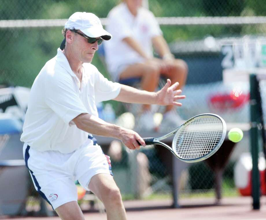 Robert Finkelstein during match against his brother, Adam, in mens 50 and over singles division in the Greenwich Town Tennis Tournament at Binney Park in Old Greenwich, Saturday afternoon, Aug. 4, 2012. Photo: Bob Luckey / Greenwich Time