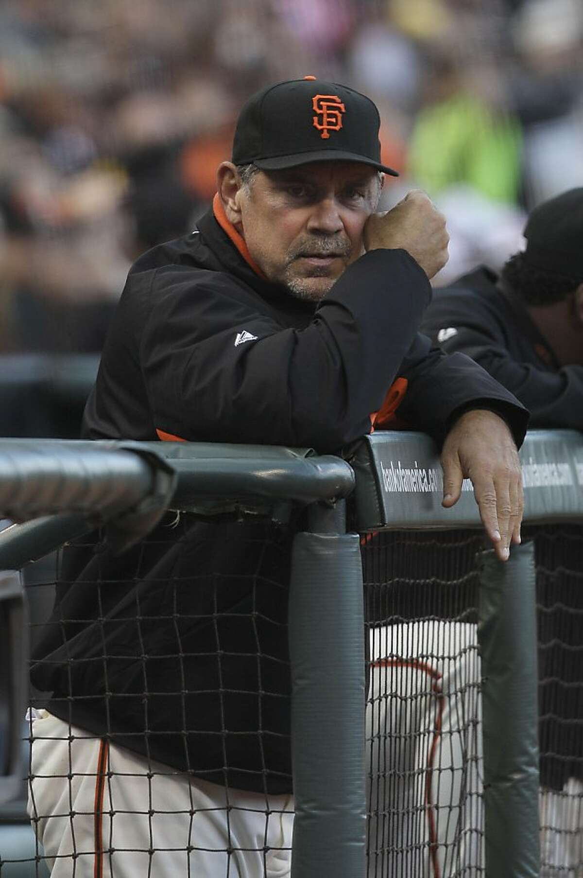 San Francisco Giants manager Bruce Bochy (15) against the Los Angeles Dodgers during a baseball game in San Francisco, Friday, July 27, 2012. (AP Photo/Jeff Chiu)