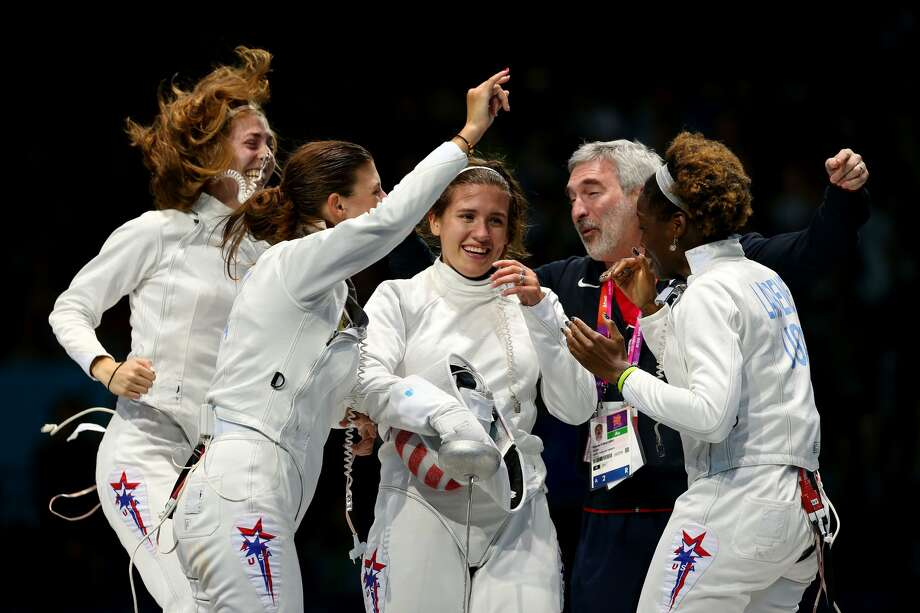 LONDON, ENGLAND - AUGUST 04:  Courtney Hurley (C) of the United States and teammates Susannah Scanlan (L), Kelley Hurley (2nd L), Maya Lawrence (R) and head coach Roberto Sobalvarro (2nd R) celebrate winning the Bronze Medal Match 31-30 against Russia during the Women's Epee Team Fencing Finals on Day 8 of the London 2012 Olympic Games at ExCeL on August 4, 2012 in London, England.  (Photo by Hannah Johnston/Getty Images) (Hannah Johnston / Getty Images)