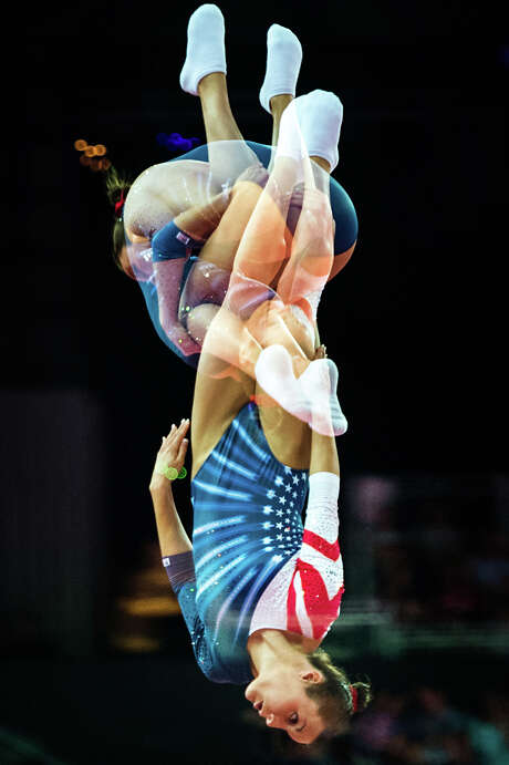 Newton's Savannah Vinsant is seen in a multiple exposure photograph during the trampoline competition. Photo: Smiley N. Pool, Houston Chronicle / © 2012  Houston Chronicle