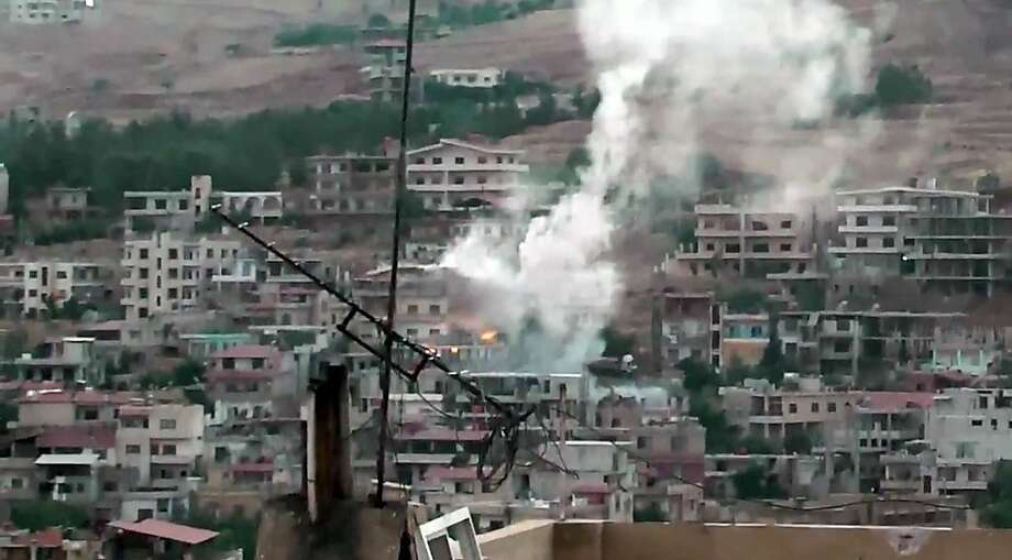 Shelling in Zabadani, near Damascus, is shown in an image by an amateur journalist. Government forces and rebel fighters stepped up their offensives. Photo: Anonymous, Associated Press