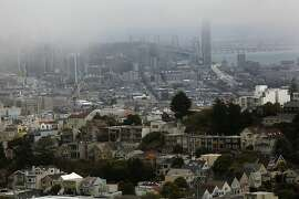 A fog bank drifting through the downtown area as Noe Valley gets some sun in San Francisco, Calif., on Friday August 3, 2012.