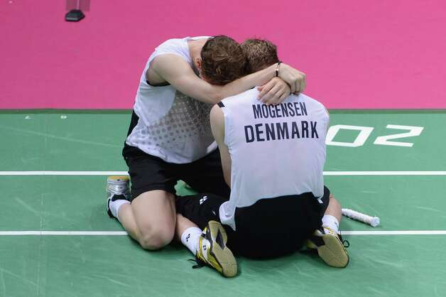Mathias Boe and Carsten Mogensen (R) of Denmark celebrate victory in their Men's Doubles Badminton Semi Final match against Yong Dae Lee (L) and Jae Sung Chung (R) of Korea  at Wembley Arena. Photo: Michael Regan, Getty Images / 2012 Getty Images