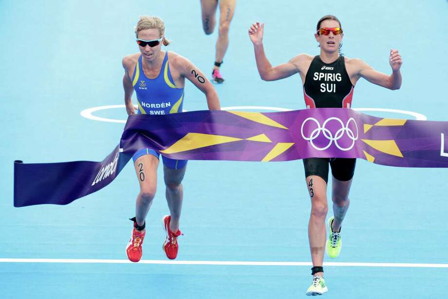 Lisa Norden of Sweden (L) and Nicola Spirig of Switzerland finish the Women's Triathlon at Hyde Park. Photo: Adam Pretty, Getty Images / 2012 Getty Images
