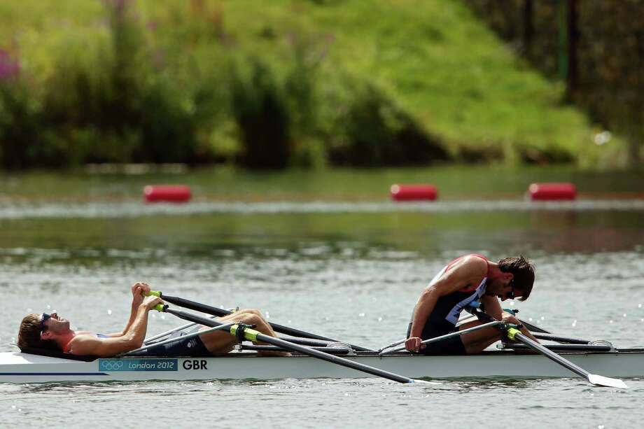 Zac Purchase and Mark Hunter of Great Britain react after finishing in the silver medal position after the Lightweight Men's Double Sculls at Eton Dorney. Photo: Phil Walter, Getty Images / 2012 Getty Images