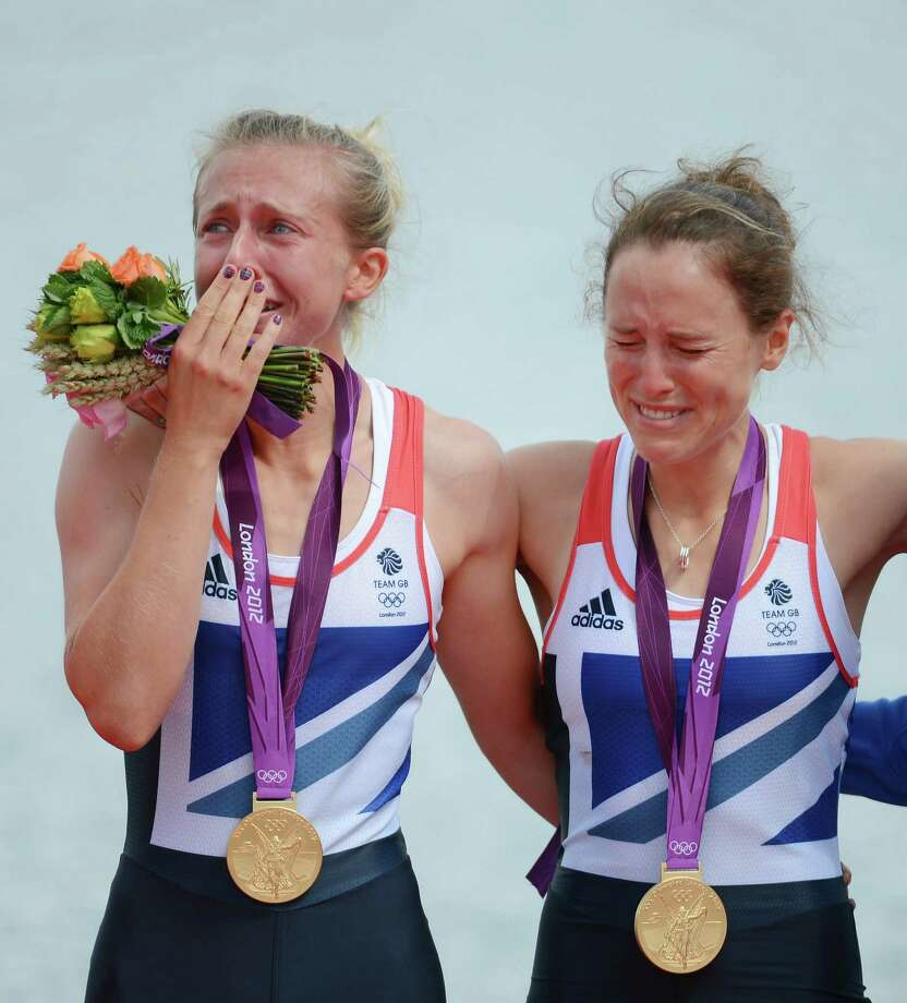 Katherine Copeland and Sophie Hosking of Great Britain celebrate with their gold medals during the medal ceremony for the Lightweight Women's Double Sculls Final at Eton Dorney. Photo: Harry How, Getty Images / 2012 Getty Images