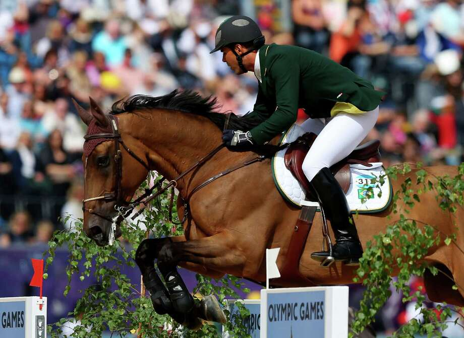 Alvaro Affonso De Miranda Neto of Brazil riding Rahmannshof's Bogeno competes in the 1st Qualifier of Individual Jumping at Greenwich Park. Photo: Alex Livesey, Getty Images / 2012 Getty Images