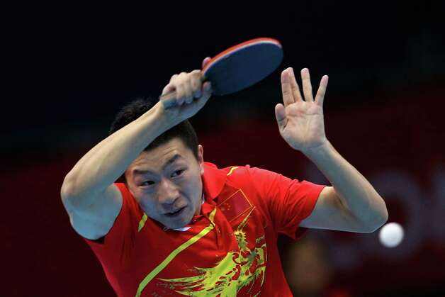 Ma Long of China completes during Men's Team Table Tennis first round match against team of Russia at ExCeL. Photo: Feng Li, Getty Images / 2012 Getty Images