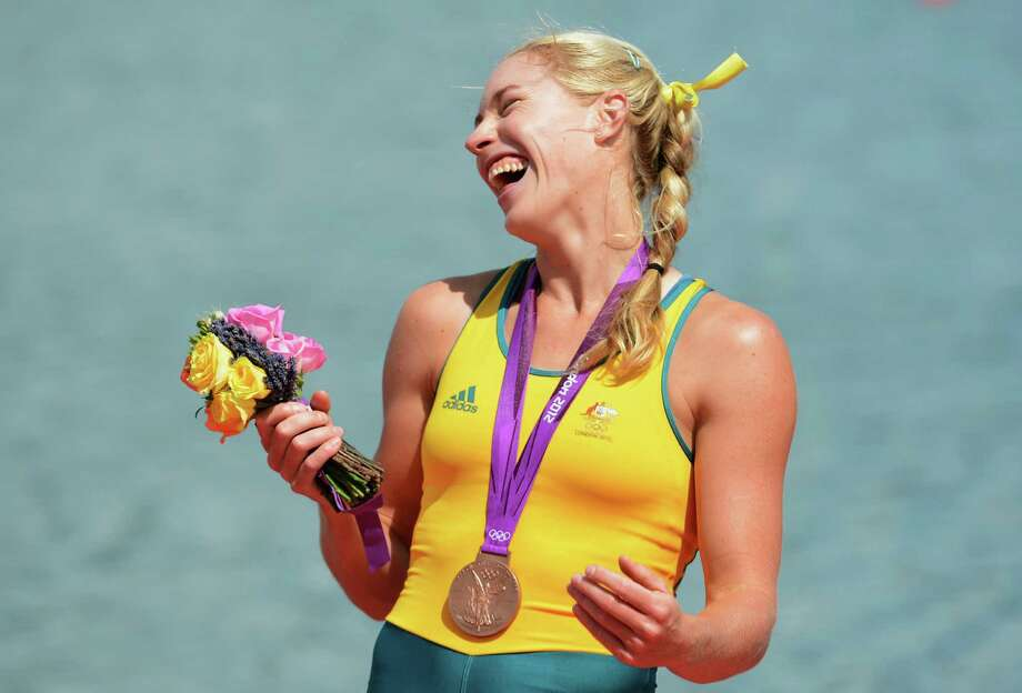 Kim Crow of Australia celebrates with her bronze medal during the medal ceremony for the Women's Single Sculls at Eton Dorney. Photo: Harry How, Getty Images / 2012 Getty Images