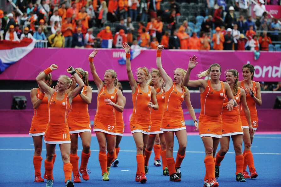The Netherlands women's hockey team wave to supporters after their win over South Korea after the Wo