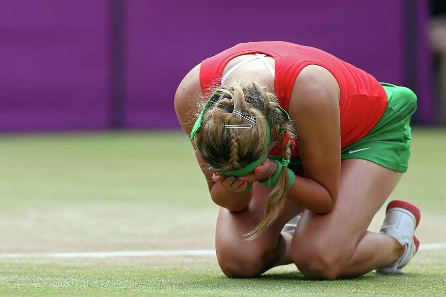 Victoria Azarenka of Belarus reacts after defeating Maria Kirilenko of Russia to win the bronze medal in the Women's Singles Tennis at the All England Lawn Tennis and Croquet Club. Photo: Elsa, Getty Images / 2012 Getty Images