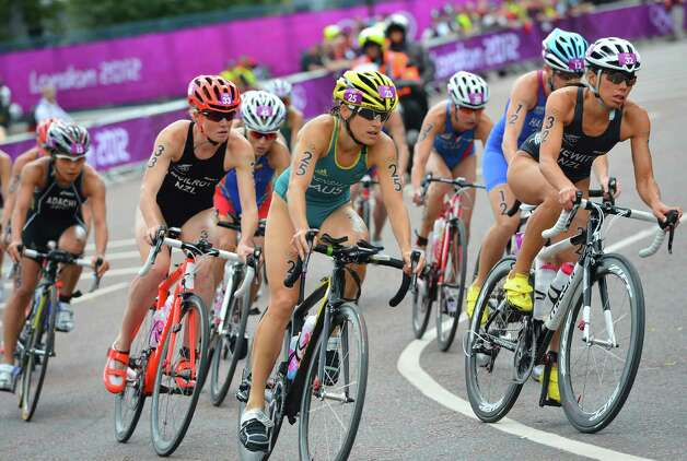 Erin Densham (C) of Australia competes in the Women's Triathlon at Hyde Park. Photo: Pool, Getty Images / 2012 Getty Images