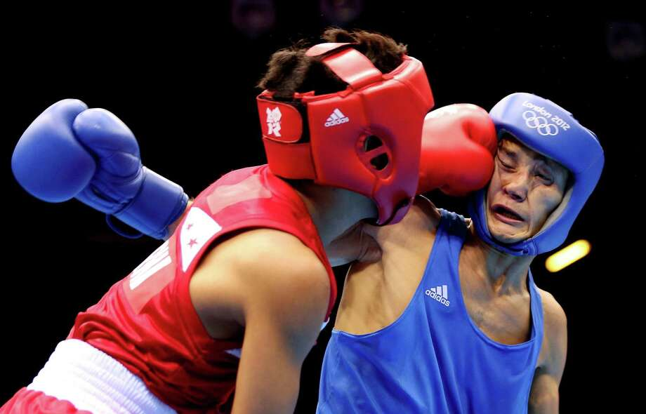 Birzhan Zhakypov of Kazakhstan (R) in action with Mark Barriga of Philippines during the Men's Light Fly (46-49kg) Boxing at ExCeL. Photo: Scott Heavey, Getty Images / 2012 Getty Images