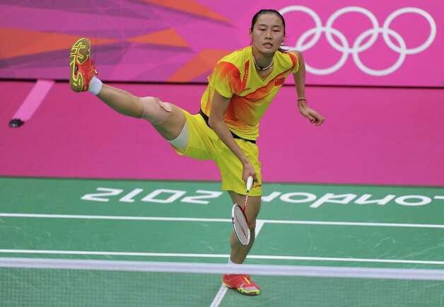 Yihan Wang of China competes during her Women's Singles Badminton Gold Medal match against  Xuerui Li of China at Wembley Arena. Photo: Michael Regan, Getty Images / 2012 Getty Images