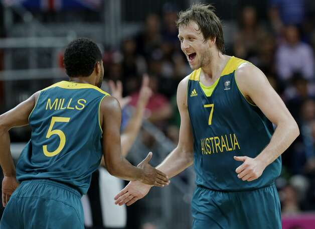 Australia's Joe Ingles (7) celebrates with teammate Patrick Mills (5) during a preliminary men's basketball game against Great Britain at the 2012 Summer Olympics, Saturday, Aug. 4, 2012, in London. (AP Photo/Eric Gay) (Associated Press)