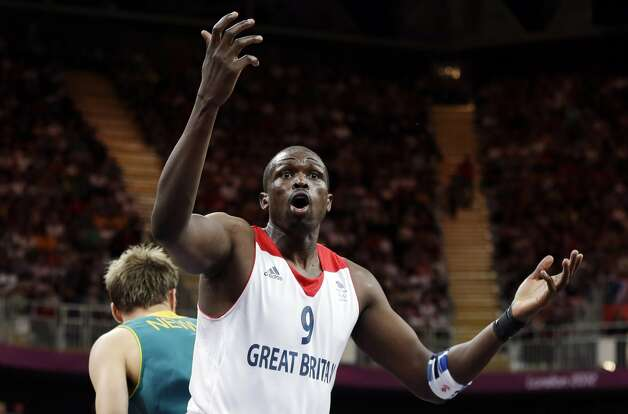Great Britain's Luol Deng (9) argues a call during a preliminary men's basketball game against Australia at the 2012 Summer Olympics, Saturday, Aug. 4, 2012, in London. (AP Photo/Eric Gay) (Associated Press)