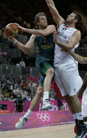 Australia's Joe Ingles (7) drives to score as Great Britain's Joel Freelan (11) defends during a preliminary men's basketball game at the 2012 Summer Olympics, Saturday, Aug. 4, 2012, in London. (AP Photo/Eric Gay) (Associated Press)