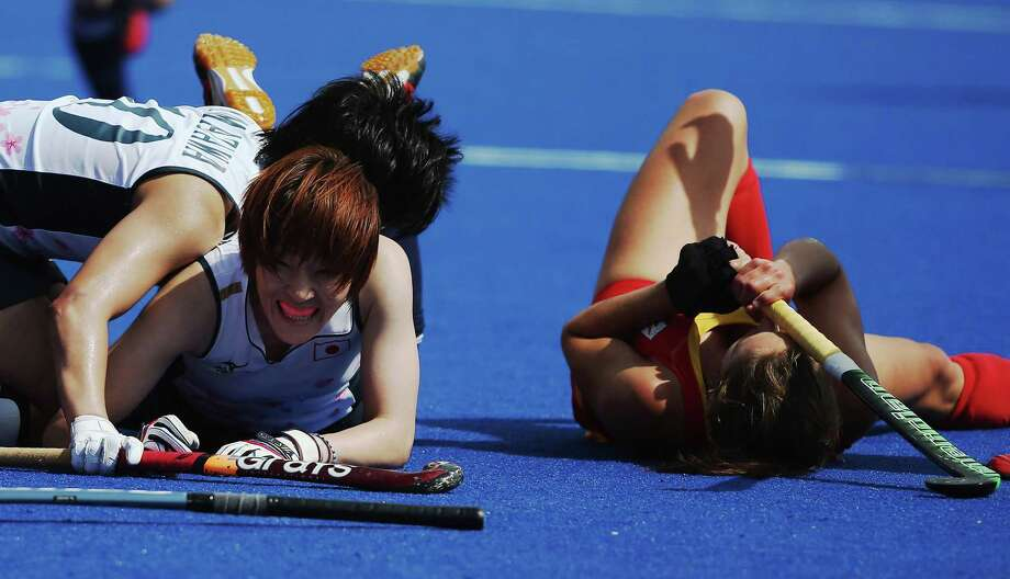 Captain Yamamoto Yukari of Japan celebrates as she lays on the ground after scoring the game equalizer during the Women's Hockey match between Japan and Belgium at Riverbank Arena Hockey Centre. Photo: Daniel Berehulak, Getty Images / 2012 Getty Images