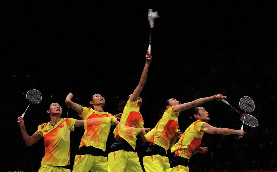 (Multiple exposures were combined in camera to produce this image.)  Yihan Wang of China competes during her Women's Singles Badminton Gold Medal match against  Xuerui Li of China at Wembley Arena. Photo: Michael Regan, Getty Images / 2012 Getty Images