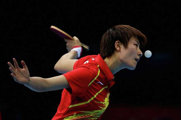 Ding Ning of China completes during Women's Team Table Tennis quarter-final match against team of Netherlands at ExCeL. Photo: Feng Li, Getty Images / 2012 Getty Images