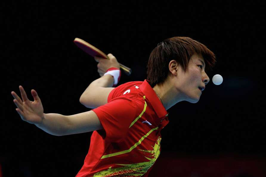 Ding Ning of China completes during Women's Team Table Tennis quarter-final match against team of Ne