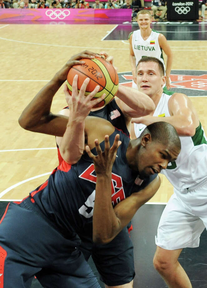 Kevin Durant of the United States fights for the ball during the Men's Basketball Preliminary Round match between Lithuania and the United States at Basketball Arena. Photo: Pool, Getty Images / 2012 Getty Images