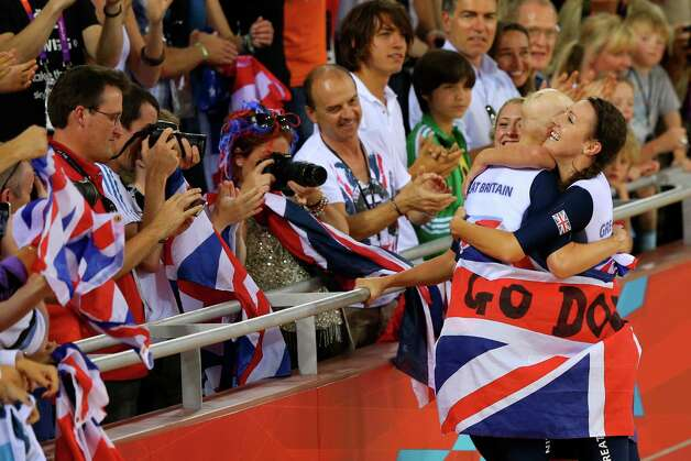 (L-R) Laura Trott, Joanna Rowsell, and Dani King of Great Britain celebrate winning the Gold medal and breaking the World Record in the Women's Team Pursuit Track Cycling Finals at Velodrome. Photo: Alex Livesey, Getty Images / 2012 Getty Images