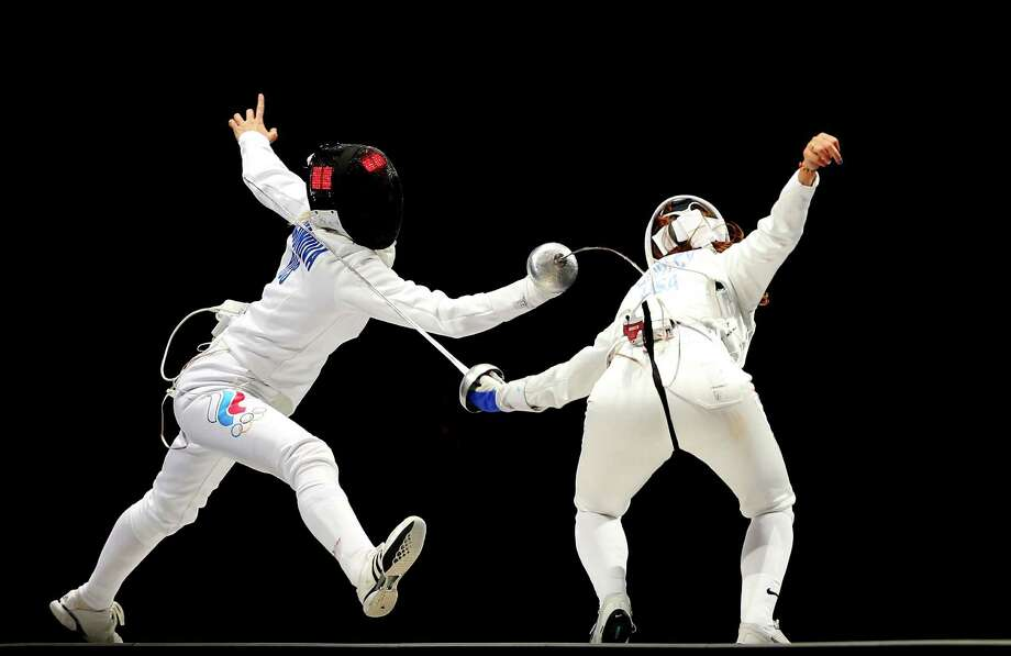 (L-R) Anna Sivkova of Russia competes against Courtney Hurley of the United States against during the Women's Epee Team Fencing Finals at ExCeL. Photo: Hannah Johnston, Getty Images / 2012 Getty Images