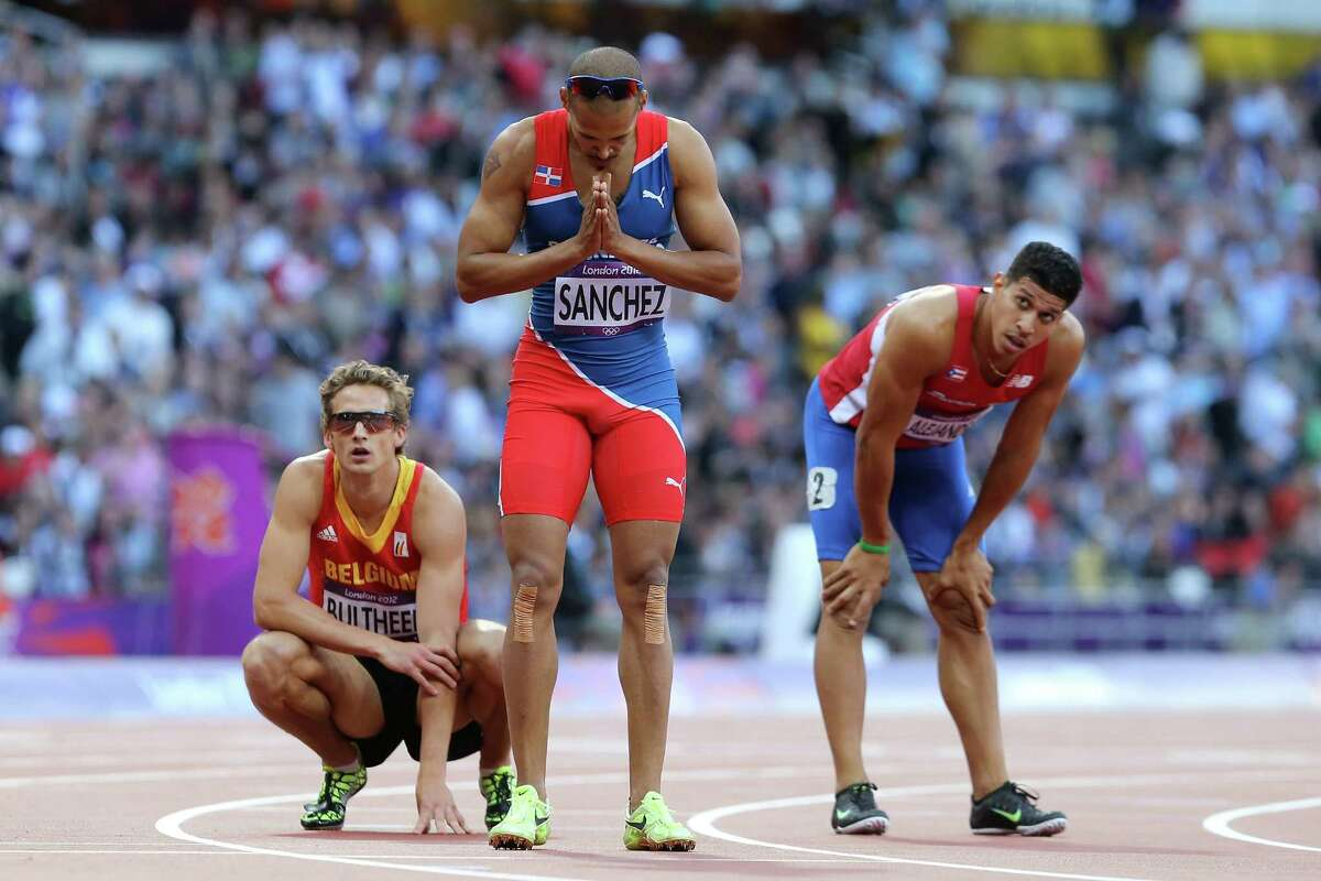 (L-R) Michael Bultheel of Belgium, Felix Sanchez of Dominican Republic and Eric Alejandro of Puerto Rico look on after the Men's 400m Hurdles Semi Final.
