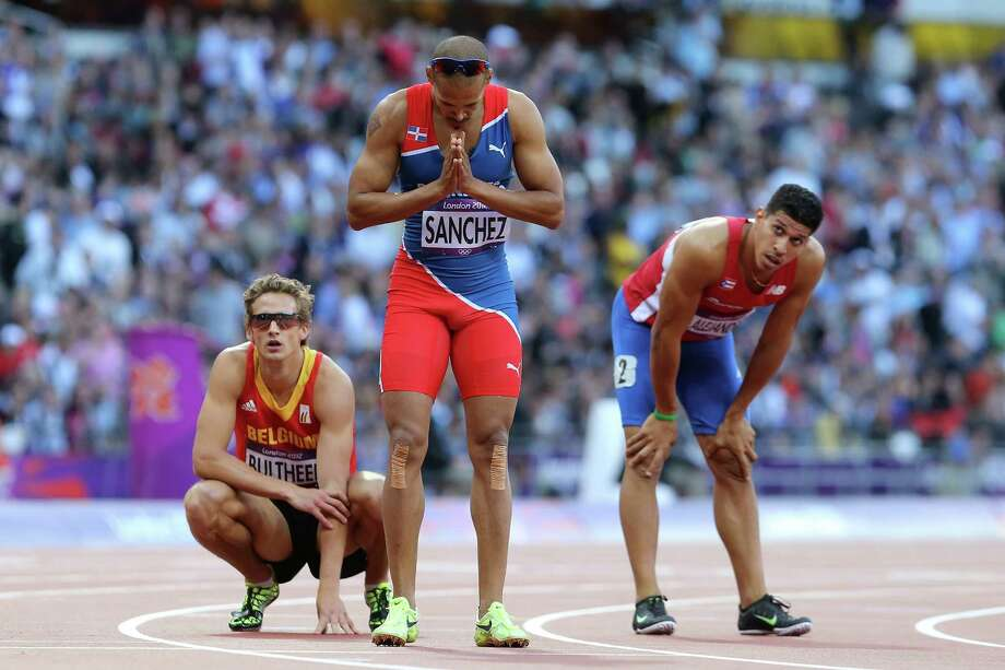 (L-R)  Michael Bultheel of Belgium, Felix Sanchez of Dominican Republic and Eric Alejandro of Puerto Rico look on after the Men's 400m Hurdles Semi Final. Photo: Streeter Lecka, Getty Images / 2012 Getty Images