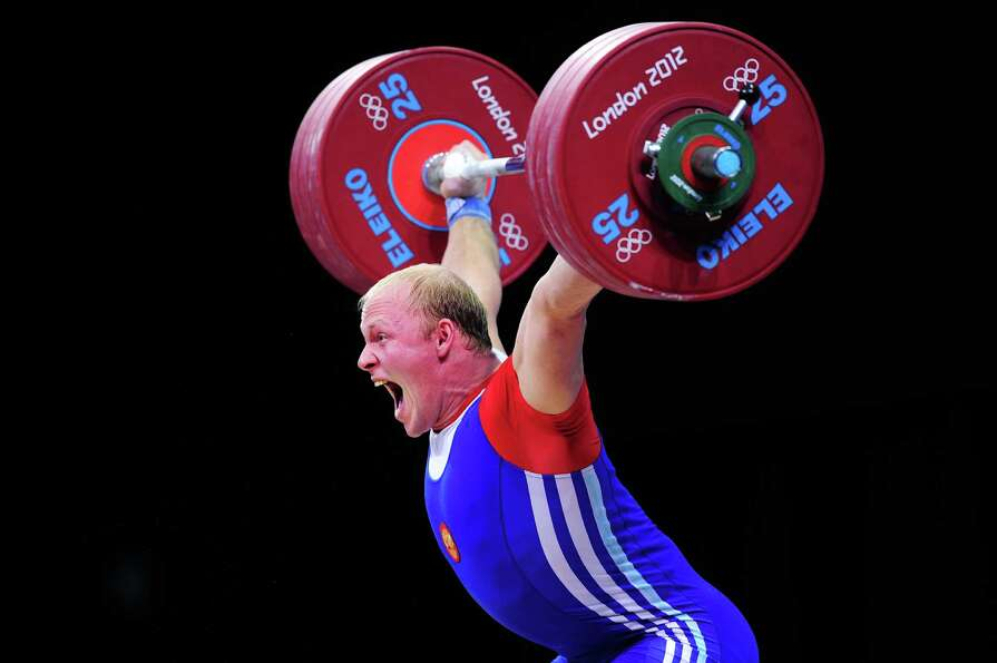 Andrey Demanov of Russia competes in the Men's 94kg Weightlifting final at ExCeL.