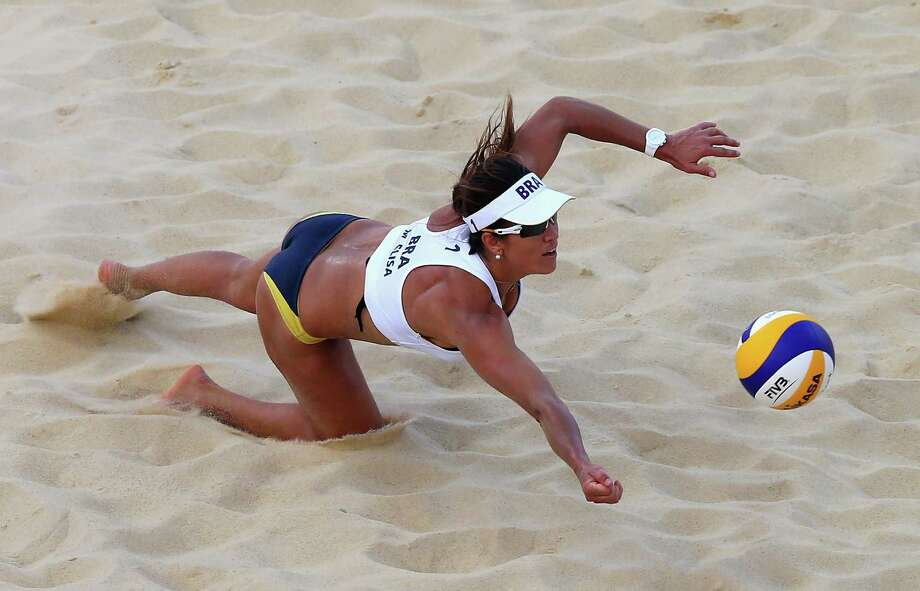 Maria Antonelli of Brazil dives for the ball during the Women's Beach Volleyball Round of 16 match between Brazil and Czech Republic at Horse Guards Parade. Photo: Ryan Pierse, Getty Images / 2012 Getty Images