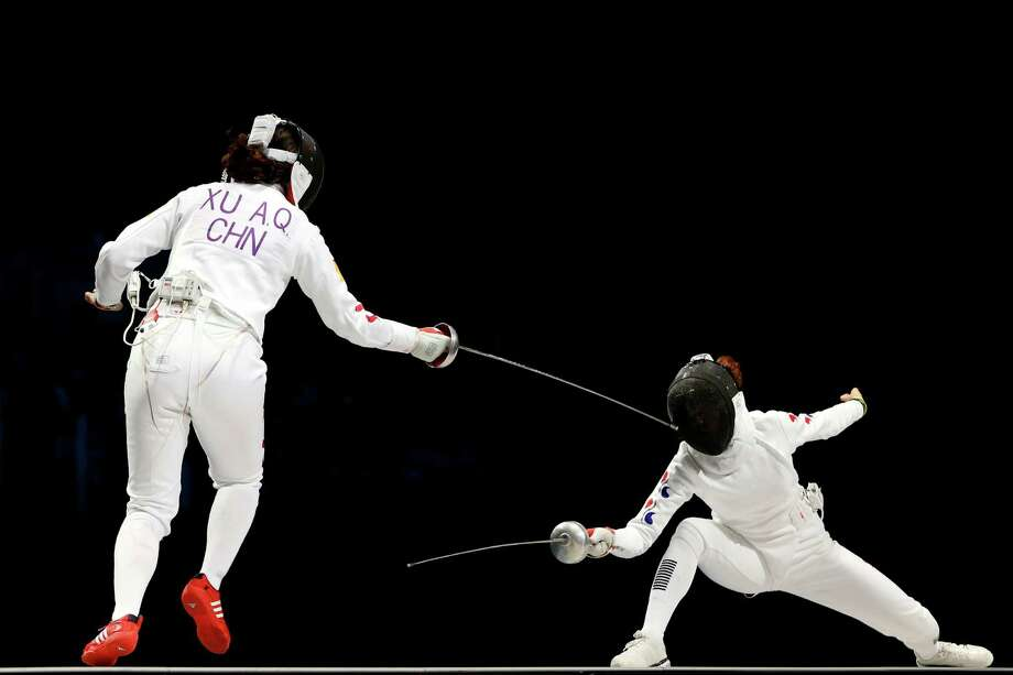 Anqi Xu of China competes against Injeong Choi of Korea during the Women's Epee Team Fencing Finals at ExCeL. Photo: Hannah Johnston, Getty Images / 2012 Getty Images