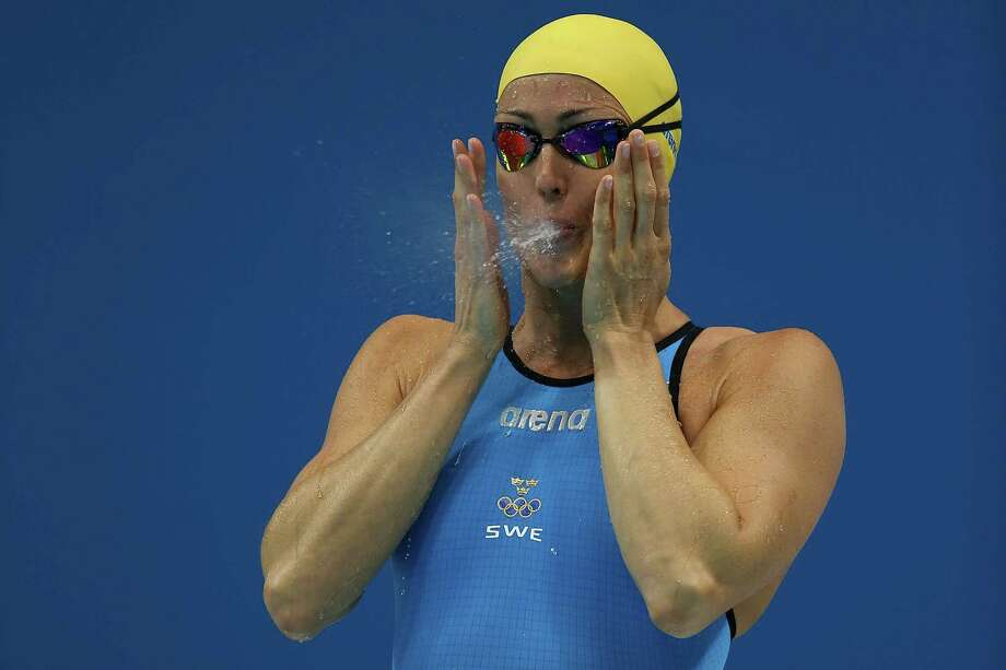 Therese Alshammar of Sweden blows water from her mouth ahead of the Women's 50m Freestyle Final at the Aquatics Centre. Photo: Clive Rose, Getty Images / 2012 Getty Images