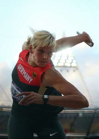 Nadine Muller of Germany competes in the Women's Discus Throw Final at Olympic Stadium. Photo: Alexander Hassenstein, Getty Images / 2012 Getty Images