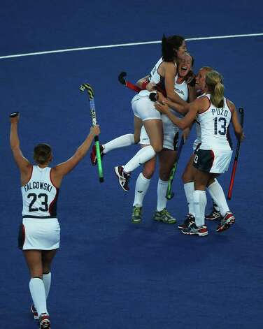 Claire Laubach of the United States celebrates with teammates after scoring during the Women's Hockey match between New Zealand and USA at Riverbank Arena Hockey Centre. Photo: Daniel Berehulak, Getty Images / 2012 Getty Images