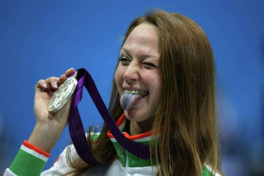 Silver medallist Aliaksandra Herasimenia of Belarus poses following the medal ceremony for the Women's 50m Freestyle Final at the Aquatics Centre. Photo: Jeff Gross, Getty Images / 2012 Getty Images