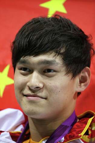 Gold medallist Yang Sun of China poses following the medal ceremony for the Men's 1500m Freestyle Final at the Aquatics Centre. Photo: Jeff Gross, Getty Images / 2012 Getty Images