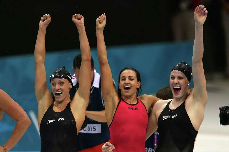 Dana Vollmer, Missy Franklin, and Rebecca Soni of the United States celebrate winning the Women's 4x