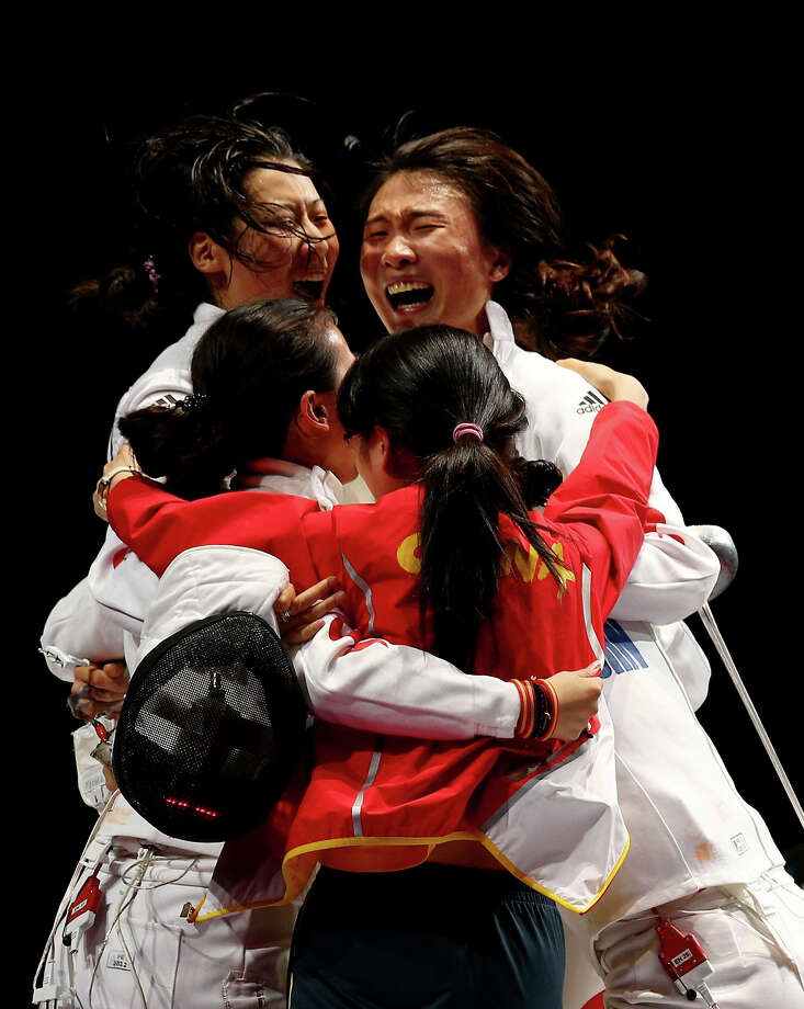 Na Li, Xiaojuan Luo, Yujie Sun and Anqi Xu of China celebrate their 39-25 win over Korea during their Gold Medal Match in the Women's Epee Team Fencing Finals at ExCeL. Photo: Hannah Johnston, Getty Images / 2012 Getty Images