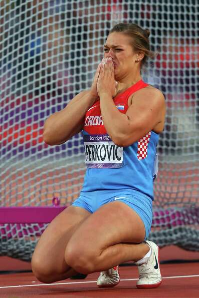 Sandra Perkovic of Croatia reacts as she wins gold in the Women's Discus Throw Final at Olympic Stad