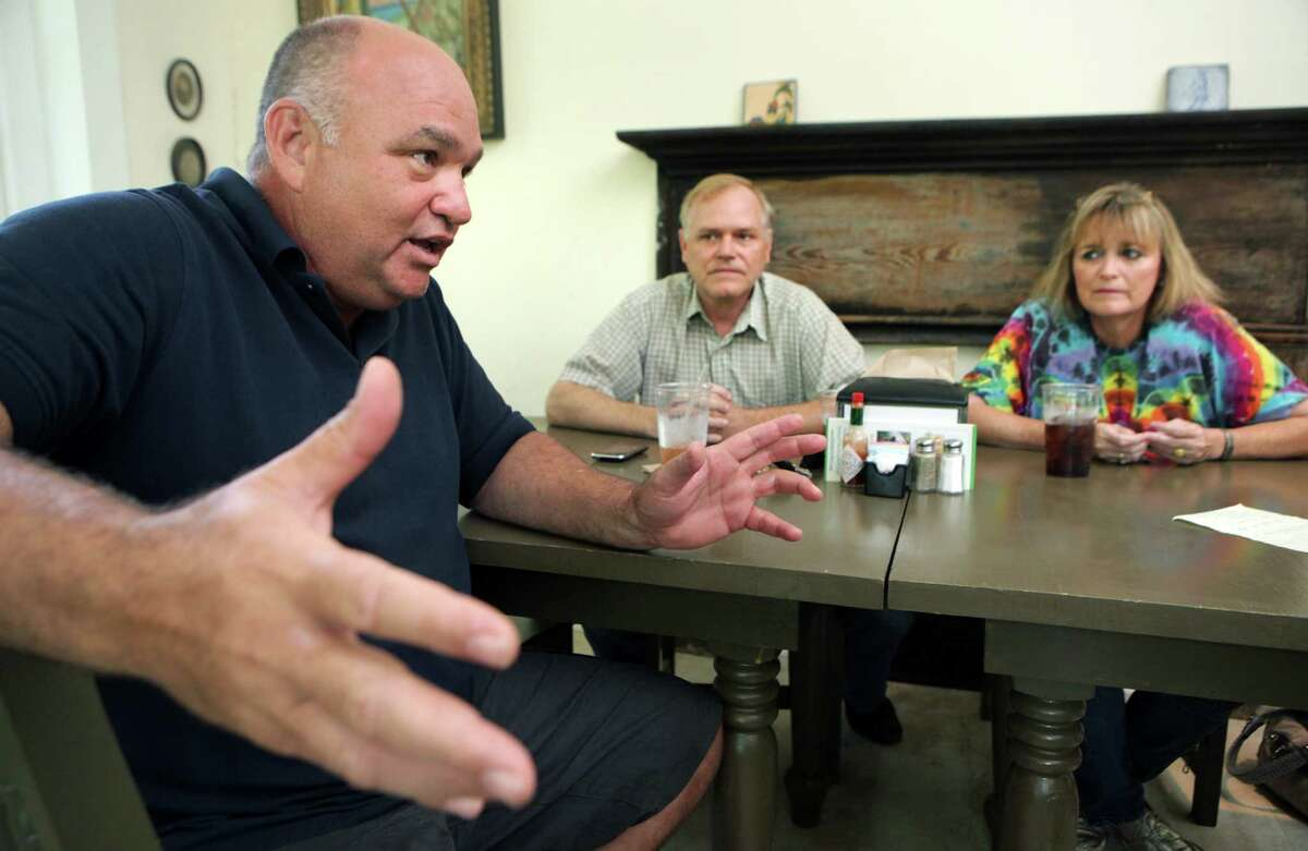 Abe Juarez, left to right, Mike Hyatt, and Julia Huber, who either live, and, or work in the 5 Points neighborhood, discuss the problems they are having with street people vandalizing area property. They met recently at Quincy's Deli, which Juarez and Hyatt co-own. Monday, July 16, 2012.