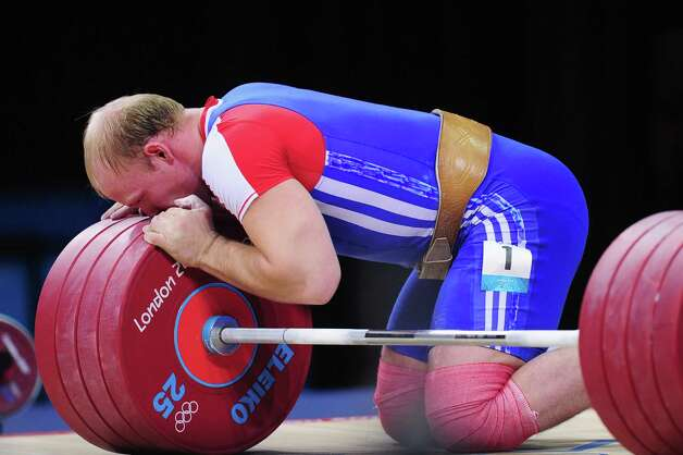 Andrey Demanov of Russia celebrates during the Men's 94kg Weightlifting final at ExCeL. Photo: Mike Hewitt, Getty Images / 2012 Getty Images
